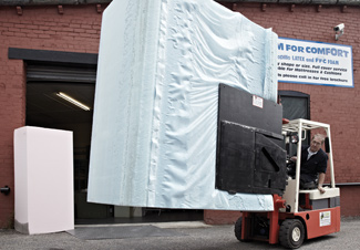 Taking delivery of a large block of foam using a fork lift truck